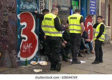 Berlin, Germany, May 1, 2017: A group of stewards have a break at labor day festivities in Berlin Kreuzberg