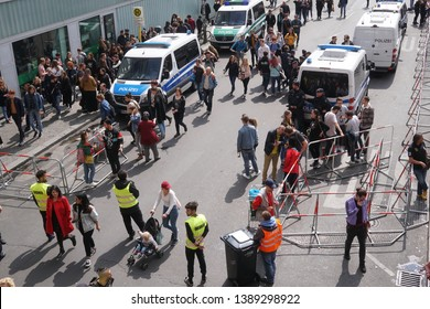 Berlin, Germany - May 1, 2019: View from above of the crowd walking in the streets of Kreuzberg district during the traditional street party at May 1, International Workers' Day