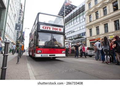 BERLIN, GERMANY - MAY 10, 2015: Bus at Checkpoint Charlie. The crossing point between East and west Berlin became a symbol of the Cold War.