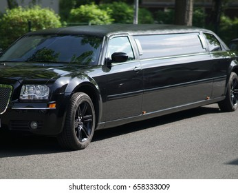 Berlin, Germany - May 12, 2017: black limousine. A limousine (or limo) is a luxury sedan or saloon car generally driven by a chauffeur and with a partition between the driver and passenger compartment