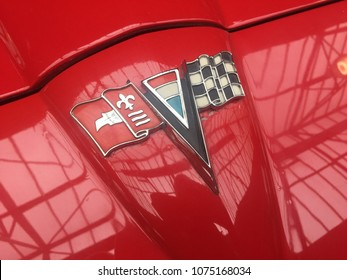 Berlin, Germany - May 13, 2017: Chevrolet Corvette Stingray emblem on red vintage car. The Chevrolet Corvette, Vette or Chevy Corvette, is a sports car manufactured by Chevrolet