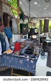BERLIN, GERMANY - MAY 13, 2018: items for sale at the flea market at Arkonaplatz, in the Prenzlauer Berg district of Berlin.