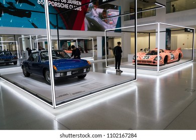 BERLIN, GERMANY - MAY 15 2018: People looking at Porsche sports cars standing at Volkswagen Group forum Drive on May 15, 2018 in Berlin, Germany.
