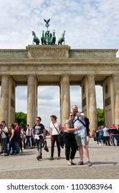 BERLIN, GERMANY - MAY 15 2018: Tourists taking pictures in front of Brandenburger Tor - Brandeburg gate on May 15, 2018 in Berlin, Germany.