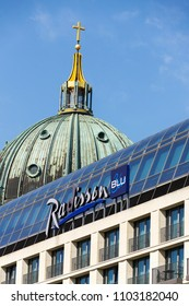 BERLIN, GERMANY - MAY 15 2018: Radisson Blu hotels and resorts logo on the building of hotel with Berlin Cathedral, Berliner Dom in background on May 15, 2018 in Berlin, Germany.