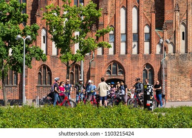BERLIN, GERMANY - MAY 15 2018: Tourists on city bike tour standing in front of evangelic St. Marys Church, Marienkirche on May 15, 2018 in Berlin, Germany.