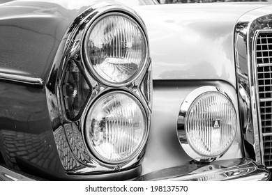 BERLIN, GERMANY - MAY 17, 2014: Headlamp of the executive car Mercedes-Benz 200 (W110). Black and white. 27th Oldtimer Day Berlin - Brandenburg