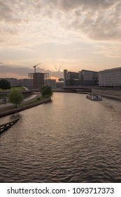 BERLIN, GERMANY - MAY 17, 2018: view of the River Spree in the government district of Berlin, with Berlin Hauptbahnhof (Central Station) in the distance.
