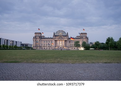 BERLIN, GERMANY - MAY 17, 2018: the Reichstag (the historic German parliament building, restored with new glass dome designed by Norman Foster), seen at dusk from Platz der Republik.