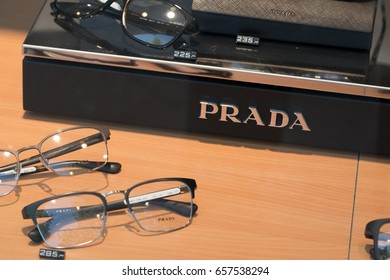 Berlin, Germany - May 19, 2017: Prada eyeglasses on window display. Prada S.p.A. is an Italian luxury fashion house specializing in leather handbags, travel accessories, shoes, ready-to-wear, perfumes