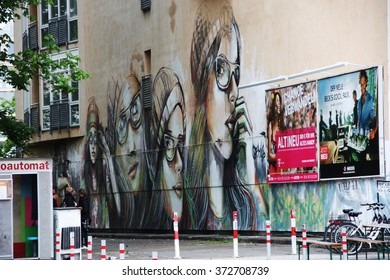 Berlin, Germany - May 2, 2014: Graffiti with girl face with glasses, on a building near the Berlin wall on the eastern side.