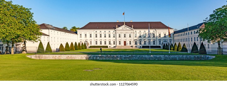 BERLIN, GERMANY - MAY 2, 2016:  Bellevue Palace in Tiergarten (Berlin) - official residence of the President of Germany with blue sky and green grass on the foreground