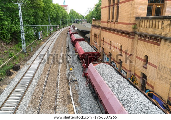 Berlin, Germany - May 2, 2019: Cargo train with aggregate stones, view from above