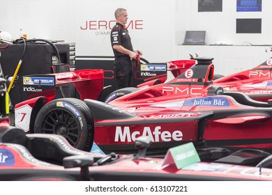 Berlin, Germany - May 20, 2016: mechanic at work checking racing McAfee car during Formula E competition. FIA Formula E Championship is a class of auto racing, using only fully electric-powered cars