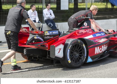 Berlin, Germany - May 20, 2016: Mechanics pushing Formula E racing car in pit lane. The FIA Formula E Championship is a class of auto racing, using only fully electric-powered cars