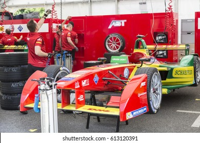 Berlin, Germany - May 20, 2016: mechanic at work checking racing car during Formula E competition. FIA Formula E Championship is a class of auto racing, using only fully electric-powered cars