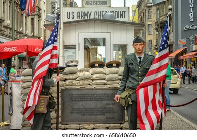 "BERLIN, GERMANY - MAY 2015: Former bordercross checkpoint ""Point Charlie"" in Berlin on May 15, 2015. It's the best-known Berlin Wall crossing point between East and West Berlin during the Cold War."