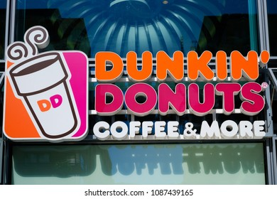 Berlin, Germany - may, 2018: The logo of Dunkin`Donuts Coffee and More in Berlin, Germany.