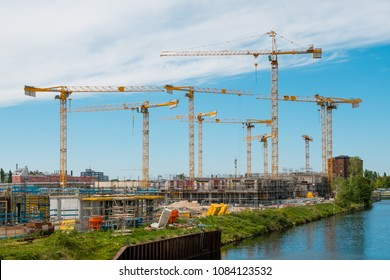 Berlin, Germany - may 2018: Many cranes on constuction site of the Quartier Europacity in Berlin, Germany