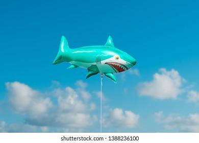 Berlin, Germany - may, 2019: A shark fish balloon on blue sky