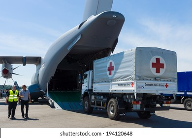 BERLIN, GERMANY - MAY 21, 2014: Shipment of humanitarian aid of the German Red Cross in military transport aircraft of the French Air Force Airbus A400M Atlas. Exhibition ILA Berlin Air Show 2014