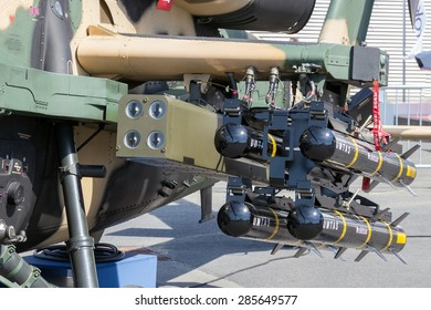 BERLIN, GERMANY - MAY 21, 2014: Roketsan UMTAS rockets on a Turkish Aerospace Industries T129 Attack helicopter at the Int. Aerospace Exhibition ILA.