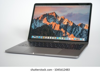 Berlin, Germany - May 21, 2017 : MacBook Pro with macOS Sierra background on the screen. MacBook Pro Retina 15-inch was created and developed by the Apple inc.