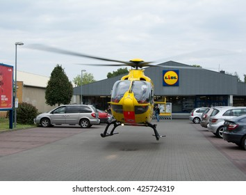 BERLIN, GERMANY - May 22, 2015: ADAC Luftrettung Eurocopter EC-135 (Registration: D-HBYH) during a medical emergency in Berlin-Lankwitz.