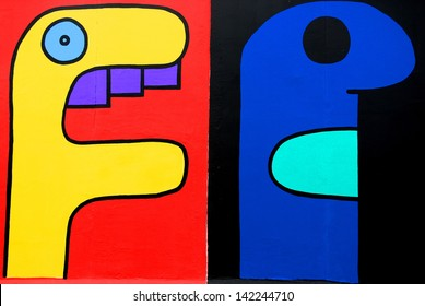 BERLIN GERMANY MAY 22: Paintings by Thierry Noir is a French artist who is claimed to be the first street artist to paint the Berlin Wall on may 22 2010 in Berlin Germany.