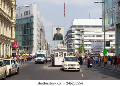 BERLIN, GERMANY - MAY 23: Tourists around the former Allied checkpoint 'Charlie' on May 23, 2014. Nowadays this site is a tourist attraction.