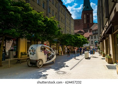 Berlin, Germany -  May 25, 2015: Street in Berlin with a view of the church of St. Nicholas. Located in the historic quarter Nikolaiviertel.