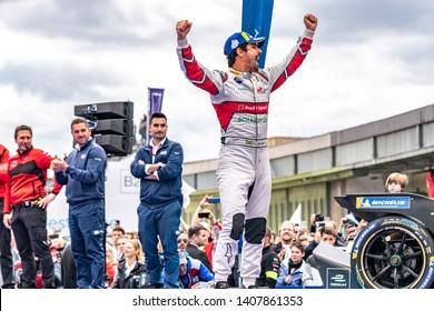 Berlin, Germany - May 25, 2019: Brazilian professional racing driver Lucas Tucci di Grassi exulting on the podium at the E-Prix ABB FIA Formula E race car Championship Award Ceremony