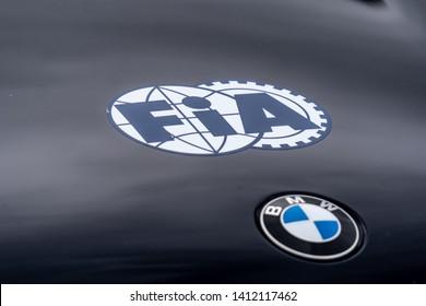 Berlin, Germany - May 25, 2019: Fia emblem on a black BMW car. The Fédération Internationale de l'Automobile (English International Automobile Federation) is an association of 246 member organisations