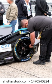Berlin, Germany - May 25, 2019: Fia mechanic checking the Michelin tires of a racecar participating in the ABB FIA Formula E street racing Championship
