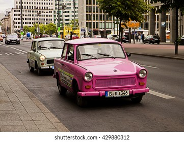 BERLIN, GERMANY - MAY 26, 2015 Berlin, vintage Trabant cars parade along the city center advertising the Trabi Museum.