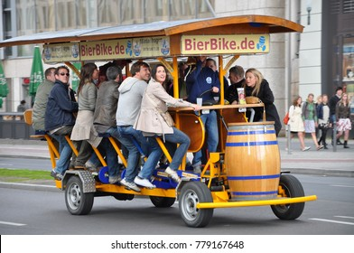 Berlin, Germany - May, 27, 2010: Young people peddle a Beer Bike