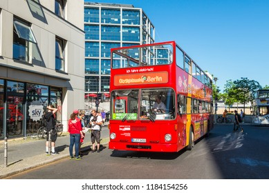 Berlin, Germany - May 27, 2017: Hop-on Hop-off sightseeing bus in the city street waiting for tourists at a stop in Berlin, Germany.