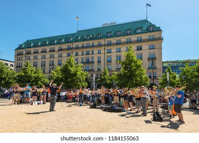 Berlin, Germany - May 27, 2017: Brass band gives a open air concert at weekend in front of the Hotel Adlon Kempinski located in Berlin's Mitte, beside the Brandenburg Gate in Berlin, Germany.