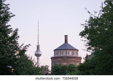 BERLIN, GERMANY - MAY 27, 2017: the Wasserturm (water tower), a key landmark in the Prenzlauer Berg district in Berlin, photographed with the Berlin Fernsehturm (TV tower) in the background.