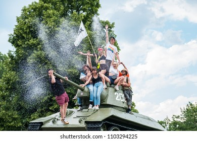 Berlin, Germany - may 27, 2018: People on tank of soviet war memorial in Berlin oprotest against AFD / Alternative for Germany (German: Alternative für Deutschland, AfD),   far-right political party