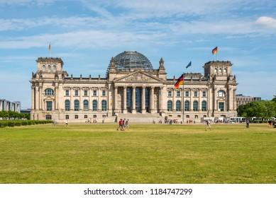 Berlin, Germany - May 28, 2017: Reichstag building, German Parliament (Deutscher Bundestag). The dedication Dem deutschen Volke, meaning To the German people, can be seen on the frieze.