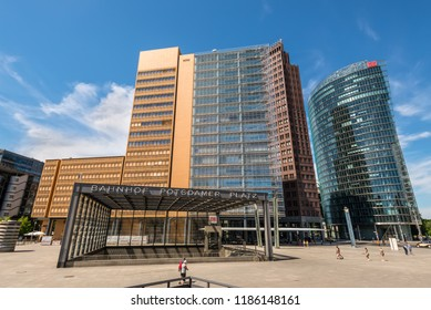 Berlin, Germany - May 28, 2017: Entrance to the Bahnhof Potsdamer Platz station at Potsdamer Platz, an important square in the center of the city, with many buildings built after the fall of the Wall.