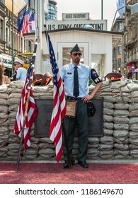 Berlin, Germany - May 28, 2017: Soldiers with uniform of the military police at Checkpoint Charlie in Berlin. Checkpoint Charlie famous passage between the West and East Berlin during the Cold War.