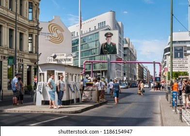 Berlin, Germany - May 28, 2017: Tourists on the street near the Checkpoint Charlie in Berlin. Checkpoint Charlie famous passage between the West and East Berlin during the Cold War.