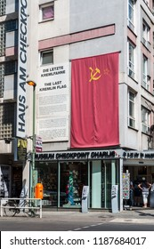 Berlin, Germany - May 28, 2017: The Last Kremlin Flag at Checkpoint Charlie Mauermuseum - Museum Haus - Wall museum in Berlin, Germany, Europe.