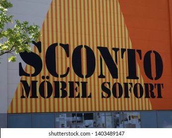 Berlin, Germany - May 29, 2018: Sconto Moebel store signage. Subsidiary of Mobel Walther AG, which today belongs to the Hoeffner Group, Sconto SB s a German retail company in the furniture industry