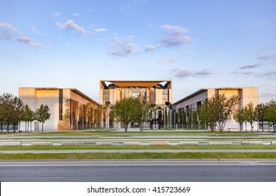 BERLIN, GERMANY - MAY 3, 2015 : The Bundeskanzleramt (German for Federal Chancellery) with colorful trees in sunrise. It is the seat of the German cancellor.