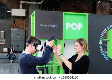 Berlin, Germany - May 3, 2018: A visitor of the re: publica tests virtual reality equipment at the booth of goethe institute. re:publica is a conference about Web 2.0, social media and digital society