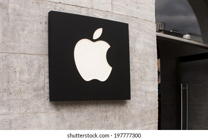 BERLIN, GERMANY - MAY 30, 2014: Apple Store logo in Berlin Kurfurstendamm. Apple Inc. is an American multinational corporation headquartered in Cupertino, California.