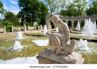 BERLIN, GERMANY - MAY 30, 2020: Figure at the Marchenbrunnen fairytale fountain from 1913 in the public Volkspark Friedrichshain in Berlin